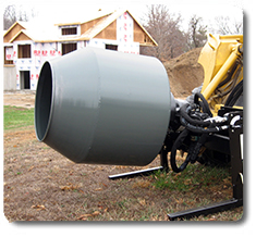 Hydraulic skid steer cement mixer, SitePro skid steer and construction site attachments.
